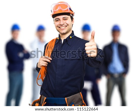 Portrait of an happy worker in front of his team - stock photo