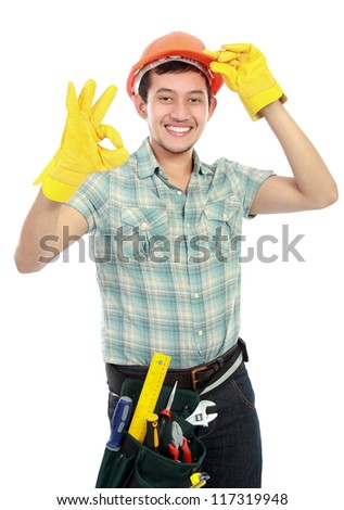 Portrait of an happy worker on white background showing ok sign - stock photo