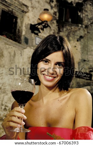 portrait of an hispanic woman with glass of wine
