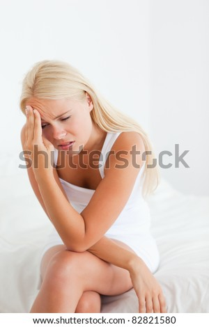 Portrait of an ill woman in her bedroom - stock photo