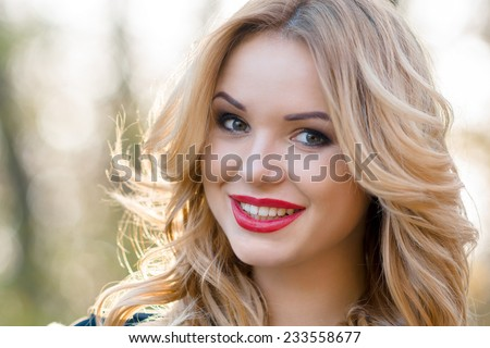 Portrait of an incredibly beautiful girl with a smile
