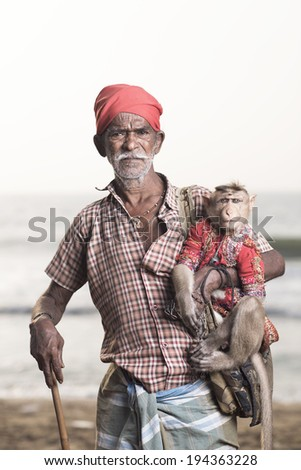 Portrait of an Indian old man with monkey