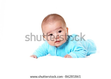 Portrait of an infant baby boy in blue clothes