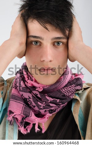 Portrait of an innocent young handsome man holding his hands on ears so he can't hear - stock photo