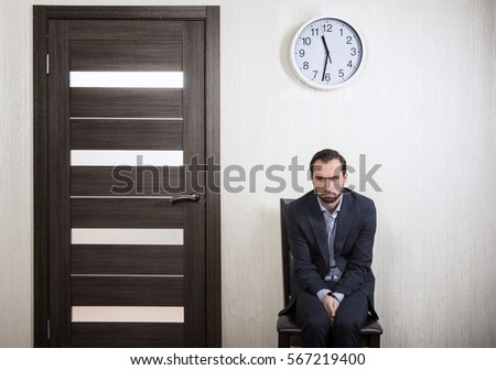Portrait of an insecure man waiting for a job interview