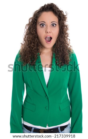 Portrait of an isolated shocked and surprised business woman in green. - stock photo