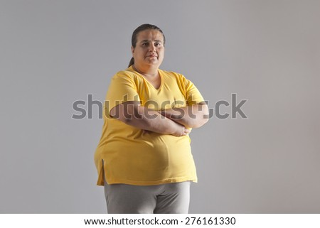 Portrait of an obese woman - stock photo
