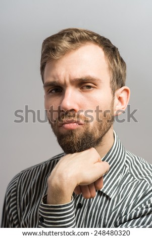 portrait of an offense man over a gray background - stock photo