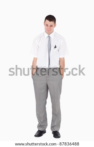 Portrait of an office worker with the hands on his pockets against a white background