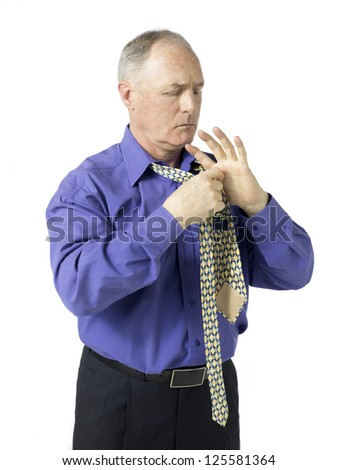 Portrait of an old businessman adjusting his tie against the white background - stock photo