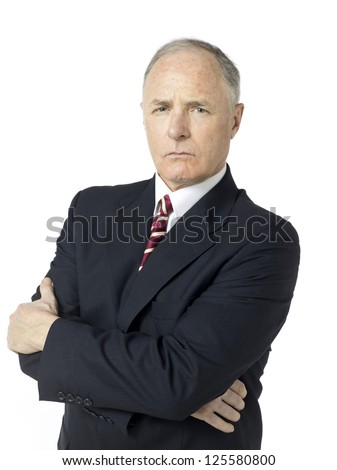 Portrait of an old businessman in suit with crossed arms isolated in a white background - stock photo