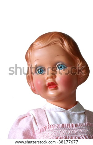 Portrait of an old doll, isolated on white.