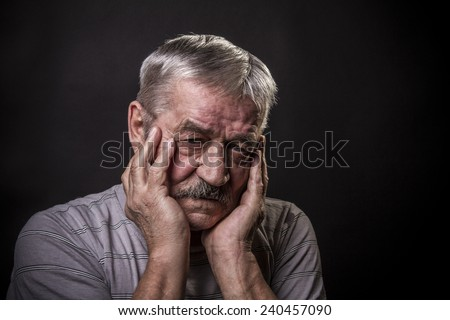 portrait of an old gray-haired man with a mustache - stock photo