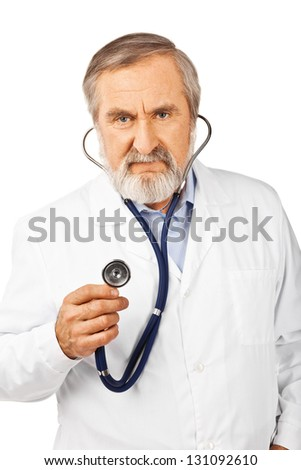 Portrait of an old male doctor with a stethoscope pointing to the camera isolated on white - stock photo