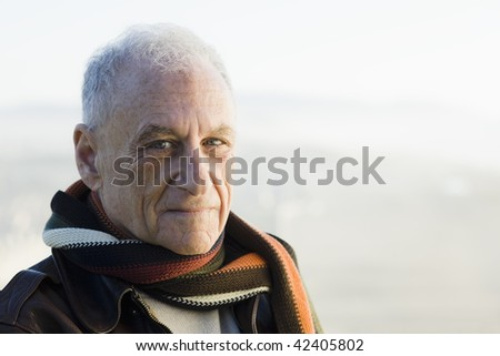 Portrait of An Old Man Looking Directly To Camera - stock photo