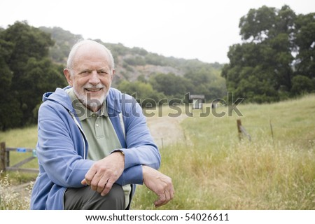 Portrait of an Old Man Resting at the End of a Nature Trail - stock photo