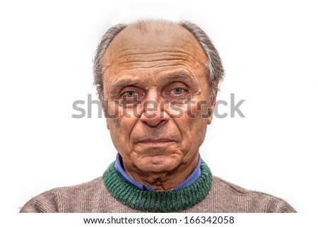 portrait of an old man with gray eyes - stock photo