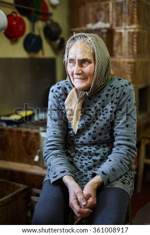 Portrait of an old rural woman indoor with selective focus