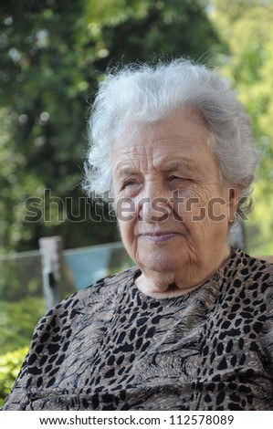 portrait of an old woman against natural background