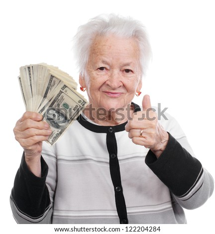 Portrait of an old woman holding money in hand and showing yes sign on white background - stock photo