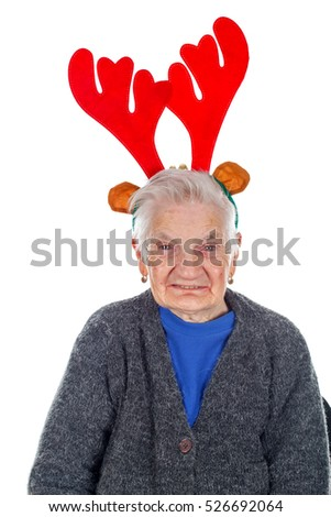 Portrait of an old woman wearing a reindeer slide on an isolated background