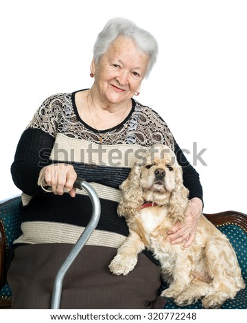 Portrait of an old woman with american spaniel on a white background - stock photo