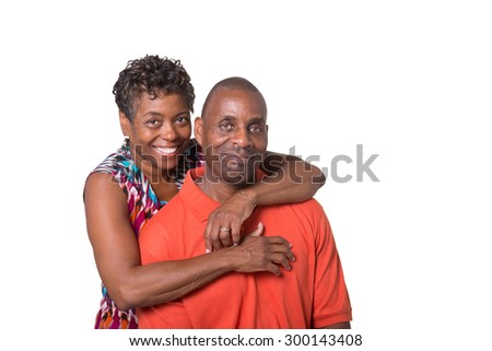 Portrait of an older couple embracing, isolated