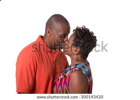 Portrait of an older couple facing kissing, isolated - stock photo