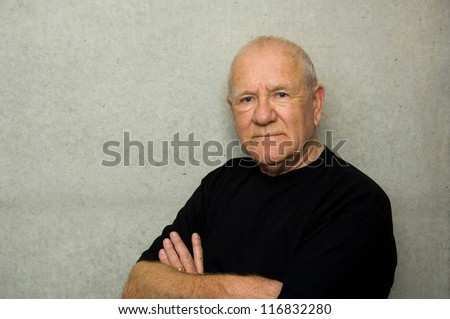 Portrait of an older man wearing black t-shirt - stock photo
