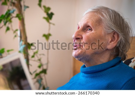 Portrait of an older woman - stock photo