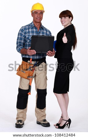 Portrait of an optimistic tradesman and engineer - stock photo