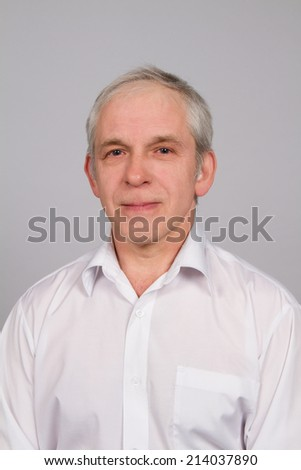 portrait of an ordinary man over gray background - stock photo