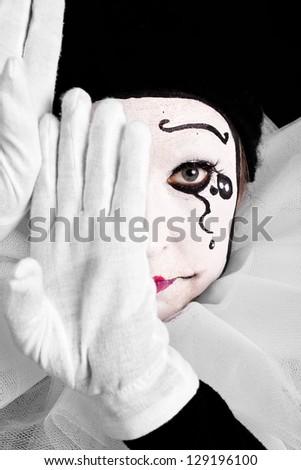 portrait of an sad female clown - stock photo