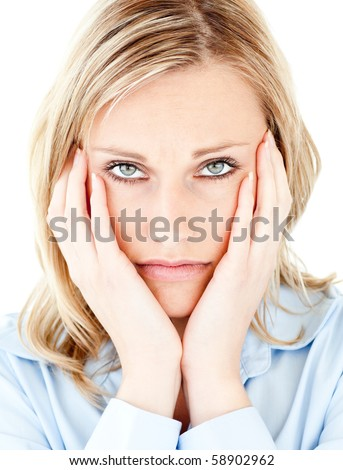 Portrait of an unhappy blond woman looking at the camera against white background - stock photo