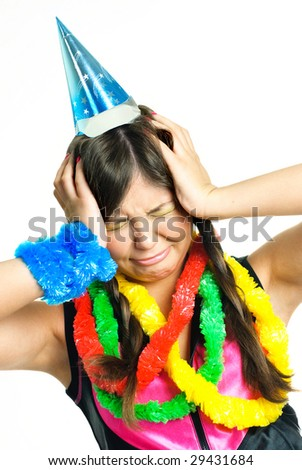 portrait of an unhappy crying girl celebrating her birthday - stock photo