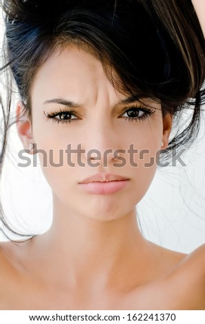 Portrait of an upset beautiful woman, Close up on girl frowning, looking unhappy and stressed. Bad hair day. - stock photo