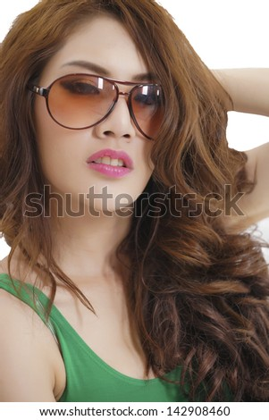 Portrait of an young Asian woman shot in a studio, model is Thai Ethnicity.