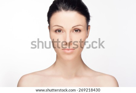 Portrait of an young girl with beautiful smile. Close-up portrait of a beautiful young woman. Skin and hair care concept. Natural look. Beauty portrait. Spa and health.