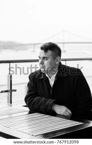 Portrait of an young happy plus size handsome European or American businessman.  businessman wearing suit, rest at city center, planning future project.