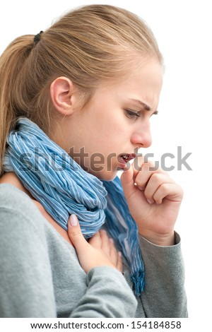 portrait of an young woman coughing with fist - stock photo