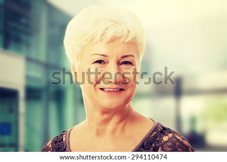 Portrait of and old, casual woman - stock photo