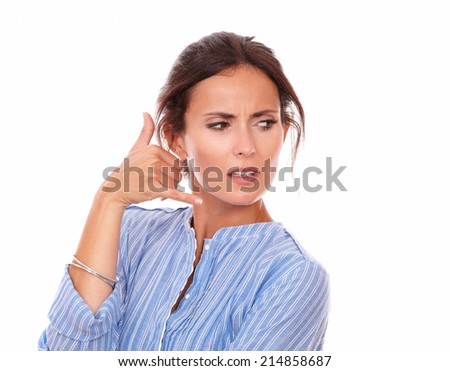 Portrait of angry adult lady wondering with call gesture while looking to her left on isolated white background - copyspace