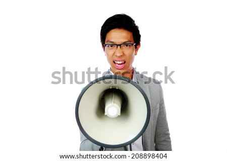Portrait of angry asian man shouting with megaphone - stock photo