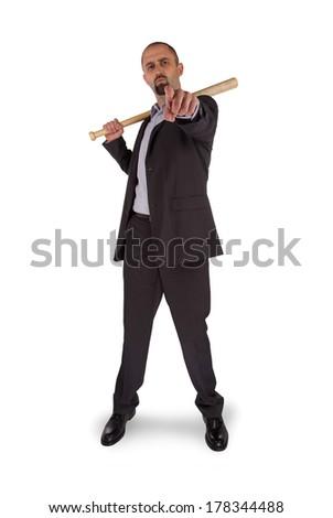 Portrait of angry businessman holding baseball bat over white background - stock photo