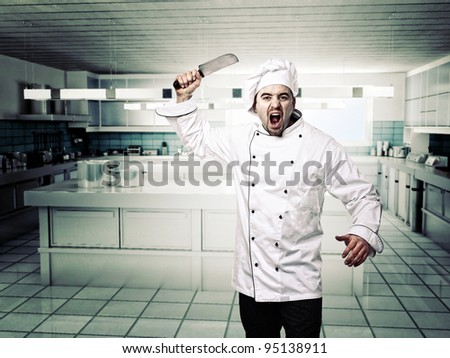 portrait of angry chef in modern kitchen - stock photo