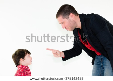 portrait of angry father scolding his son pointing finger, isolated on white background - stock photo