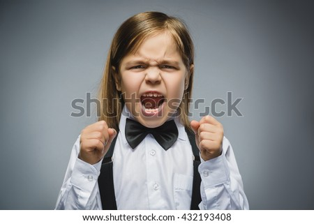 Portrait of angry girl with hand up yelling isolated on gray background. Negative human emotion, facial expression. Closeup