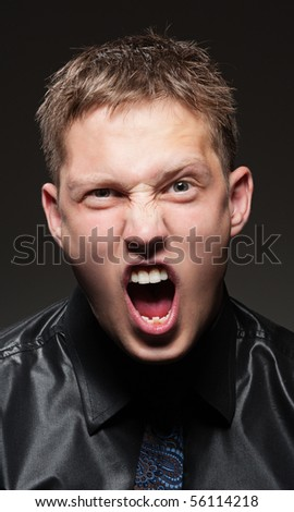 portrait of angry man over dark background