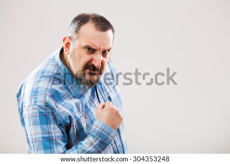 Portrait of angry man who threatens - stock photo