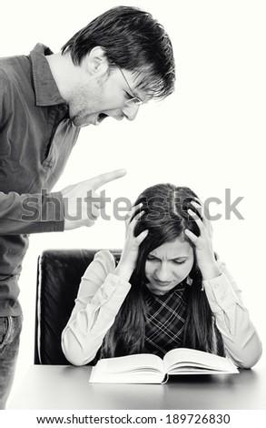 Portrait of  angry menacing teacher threatening student .Black and white - stock photo